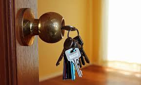 front door keyUnlocking Door  Hand Hold Keys To Locking Or Unlocking The Door