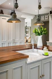 rustic pendant lighting in a farmhouse kitchen