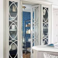 Glass Mullion Pantry Double Doors Flanked by Glass China Cabinets