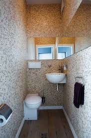 wall mounted soap dispenser powder room contemporary with baseboards bathroom mirror mosaic image by