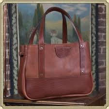 see all photos to american made leather bags