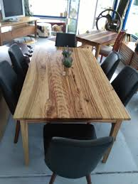 camphor dining table on tapered leg base