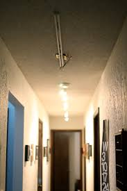 wondrous ceiling lamps as inspiring modern hallway lighting added artwork portray frames hang on grey wall panels as cool interior home decors