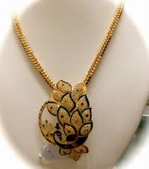 gold chain with peacock pendant