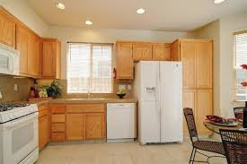 kitchens with wood cabinets and white appliances.  Appliances Kitchen Paint Color Ideas With Oak Cabinets For Kitchens Wood And White Appliances E