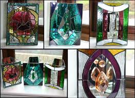 candles holders have one face of stained glass and 3 sides of mirror to reflect the candle when lit very effective and attractive
