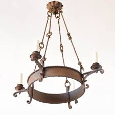 rustic chandelier with elongated rods and 4 lights from france