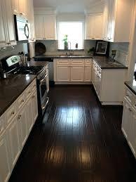 white kitchen cabinets with dark floors kitchen dark counters dark floors white cabinets wall colors for white kitchen cabinets with dark floors