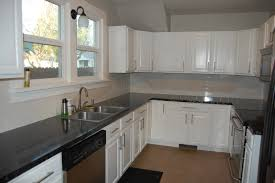 fancy l shaped kitchen ideas added custommade paint cabinets white feat black granite countertops and double glass sliding windowed decorations