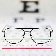 Close Up Of Glasses On Eye Chart Studio Shot D1028_29_361