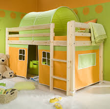 sunny yellow kids bedroom with bunk bed and bed tent and tedy bear doll