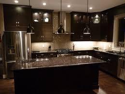 image of dark granite countertops with light cabinets