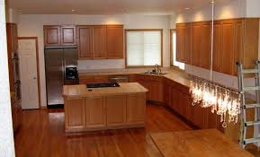 modern kitchen with dark granite and light maple cabinets country