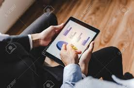 Reading Investment Charts Two Young Partner Business Man Investor Talking And Reading Information