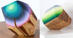 wood blocks carved and painted into glimmering gemlike objects by victoria wagner colossal