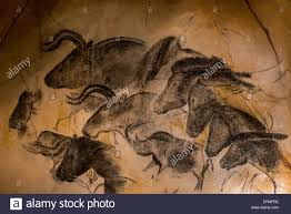 replica of prehistoric rock paintings of the chauvet cave ardèche france showing woolly rhinoceros aurochs and wild horses