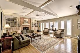 attractive recessed lighting layout for living room with fireplace and square area rugs