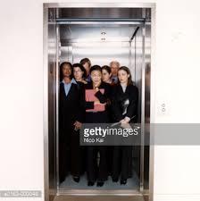people standing in elevator. keywords people standing in elevator