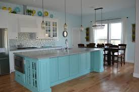 white kitchen cabis with teal island grey quartz countertops turquoise white wallpaper turquoise white and grey bedroom