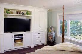 custom bedroom tv wall unit with built