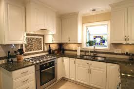 granite countertops with white cabinets image of antique white kitchen cabinets with black granite grey granite