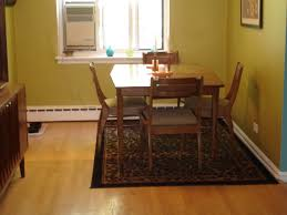 area rug under dining room table black