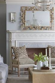 cindy rinfret lots of greek key inspiration pillows fireplace mantel and mirror in