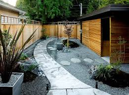In this example, we observe the traditional for the dry rock gardens gravel  base shaped with circles and waves. This solution is not only very visually  ...