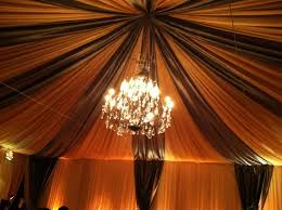 canopy full ceiling swag with large wrought iron chandelier