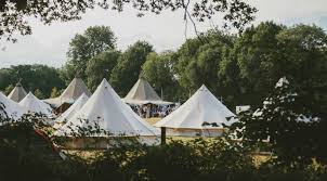 the venue bell tents at festival style wedding
