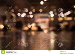 restaurant table top lighting. Download Wood Table Top With Reflect On Blur Of Lighting In Cafe,restaurant Stock Image Restaurant