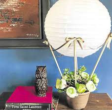 rest the paper lantern in between the sticks and you ll have your hot air balloon centerpiece