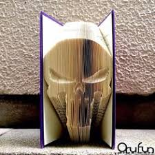 orufun the art of folding book pages to create 3d sculptures of pop culture characters and logos