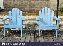Light Blue Plastic Adirondack Chairs Adirondack Chairs In Dock In Stock Photos Adirondack