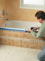 after 24 hours clean the area where the tile and tub meet with rubbing alcohol then put tape on the edge of the tub and the face of the tile