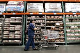 a per walks past shelves of bread at a seattle costco costco whole corp