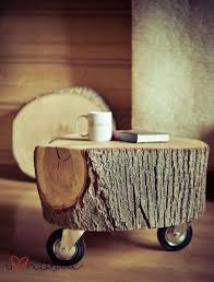 i think i want a couple of your stumps to do this with i will use them as coffee tables on the patio and move the table i have up to the awesome tree trunk coffee table