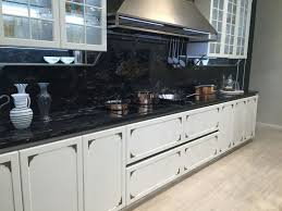 if you have a warm toned floor such as beige or cream color then we recommend a black marble backsplash with matching countertop for an oomph worthy look