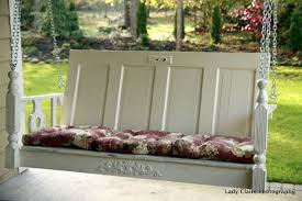 an old door is used to make a great porch swing