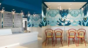ocean themed seafood restaurant with marvelous sea patterned painted wall featuring simple wooden dining table and reddish brown bentwood dining chair