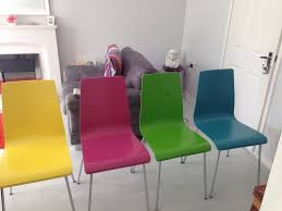 4 coloured dining chairs from john lewis pink blue yellow and green