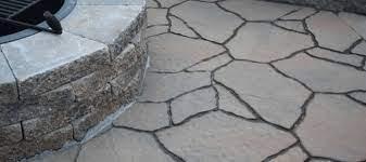 installing pavers over a concrete patio