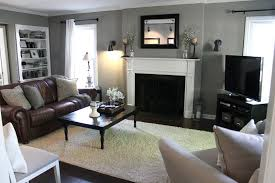 grey walls brown furniture. Living Room With Gray Walls, Brown Leather Couch, White Fireplace, Black Curtain Rods Grey Walls Furniture