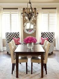 chic dinning room in black white beige and pink accents