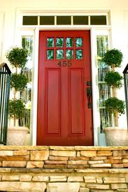 front door with windowRed front door with small windows along the top with transom and