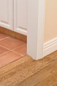 how much space do you leave for a laminate flooring transition molding hunker