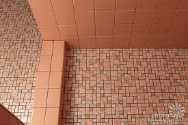 kate finishes installing her b w pink bathroom wall tiles finally retro renovation