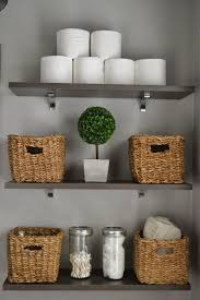 Take toilet paper out of the plastic and stack them. Baskets and glass  canisters make  Bathroom Storage SolutionsBathroom Storage ShelvesSmall ...