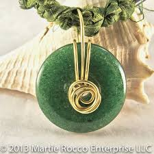 green goldstone donut wire wrapped pendant with silk and leather product images of