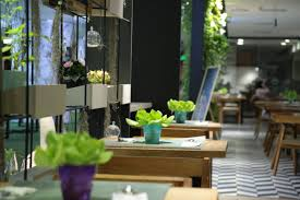sustainable restaurant furniture. Dubbed Leaf In (stylized As LeafIN), The Restaurant And On-site Garden (which Opened On December 10) Stand Out Like A Determined Blade Of Grass Sprouting Sustainable Furniture